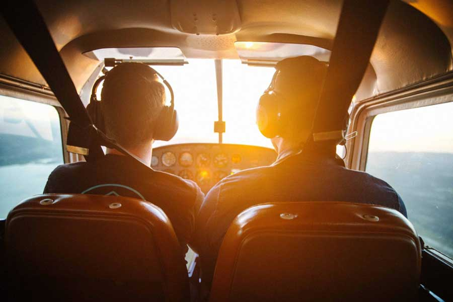 Student pilot and instructor flying