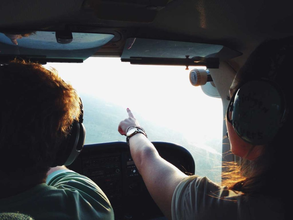 Flight instructor and students in helicopter