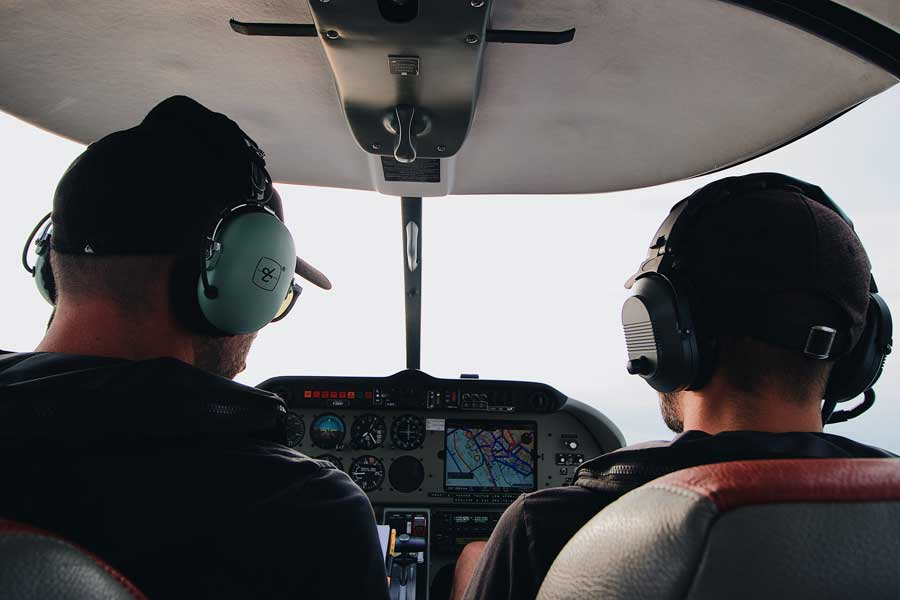 flight instructor teaching student while flying