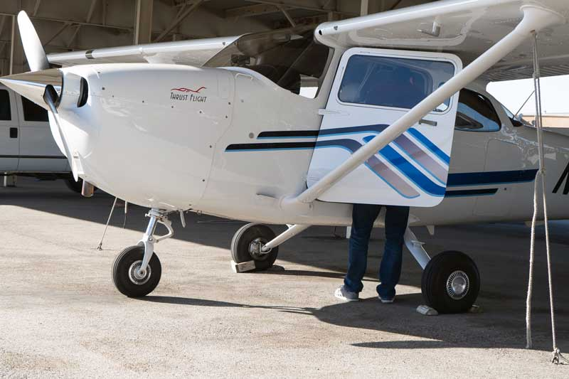 flight instructor checking the plane