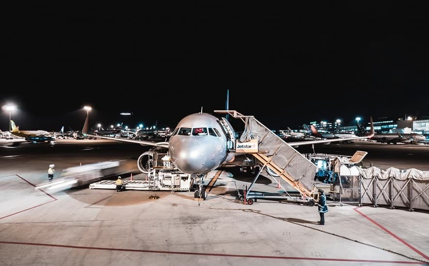 Airline on tarmac at night
