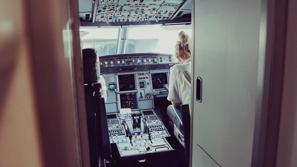 Female airline pilot in the cockpit
